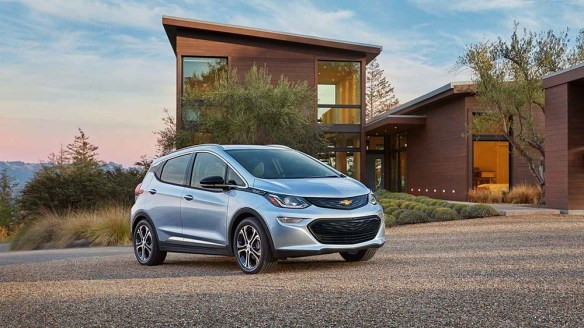 2017 Chevrolet Bolt by a modern home